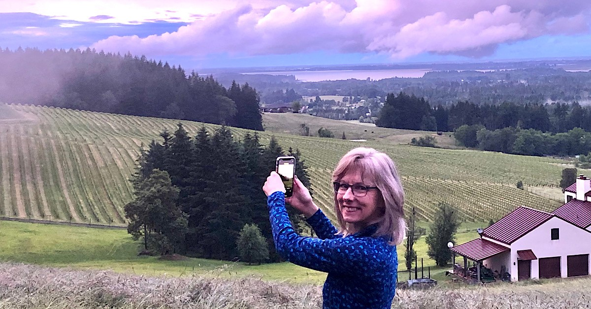 My Story page: Pam Spettel of 101-Mile Kitchen photographing a view of the Southern Willamette Valley from her house.