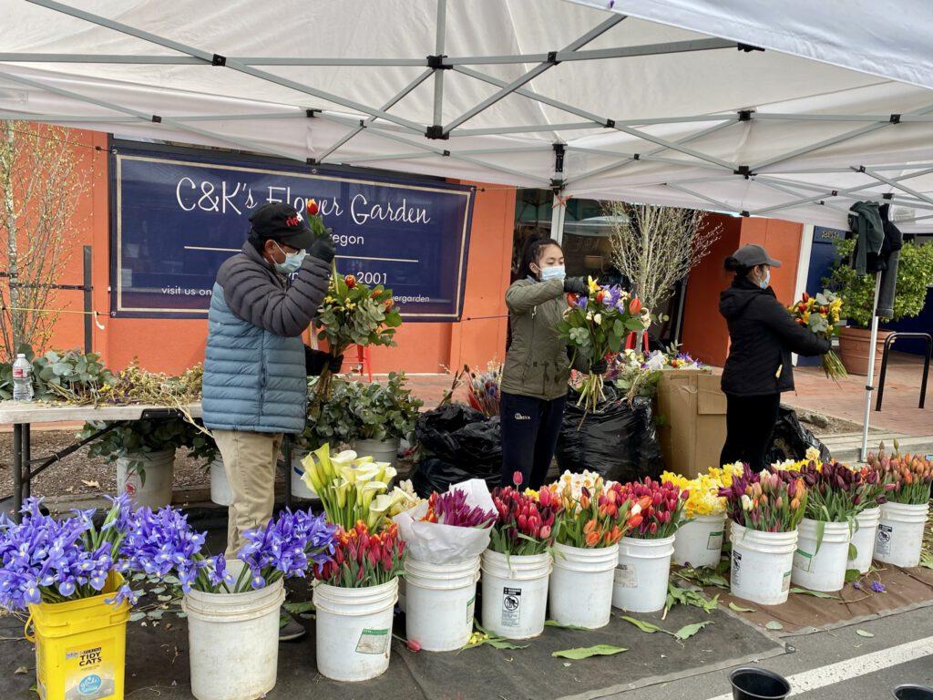 flower vendors making bouquets