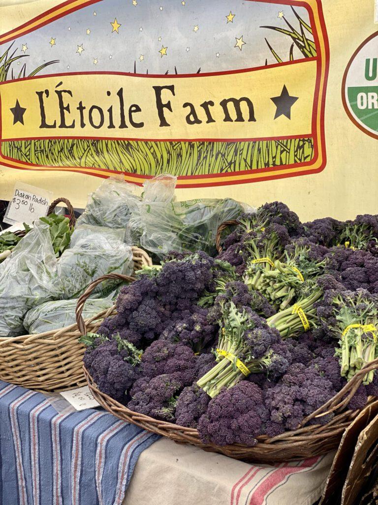 baskets of purple broccoli and radishes
