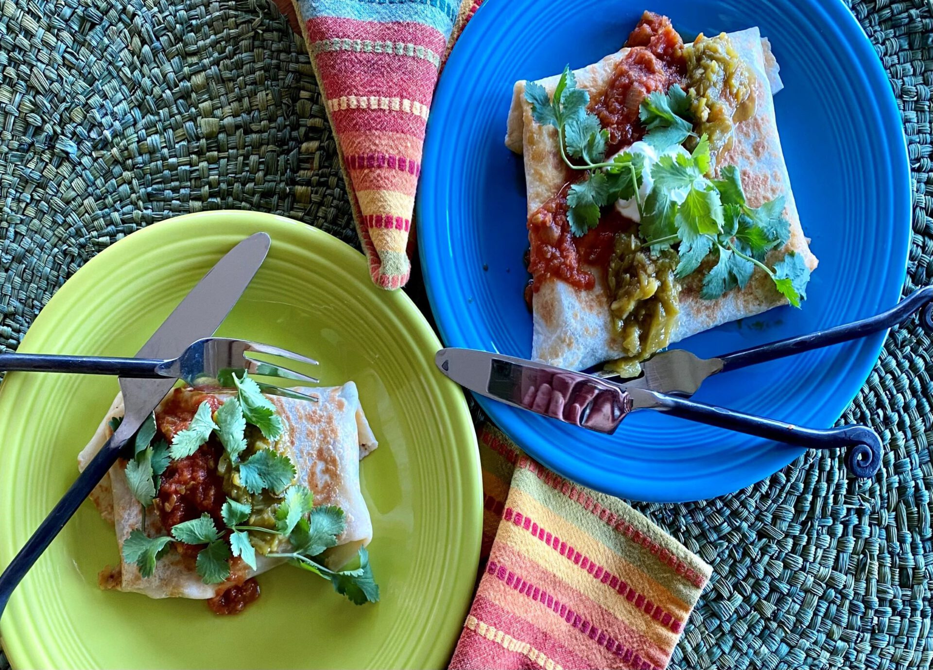 burritos on green and blue plates