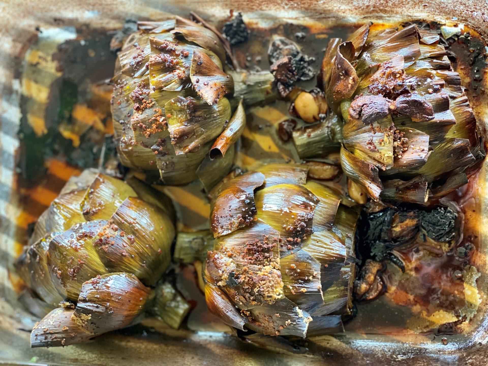 wine-roasted artichokes on baking dish