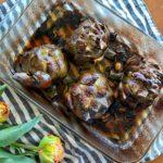 roasted artichokes in baking dish