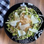 asparagus bean salad on black plate