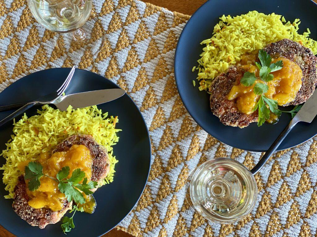 curried slalmon cakes, coconut rice, and mango chutney on plates
