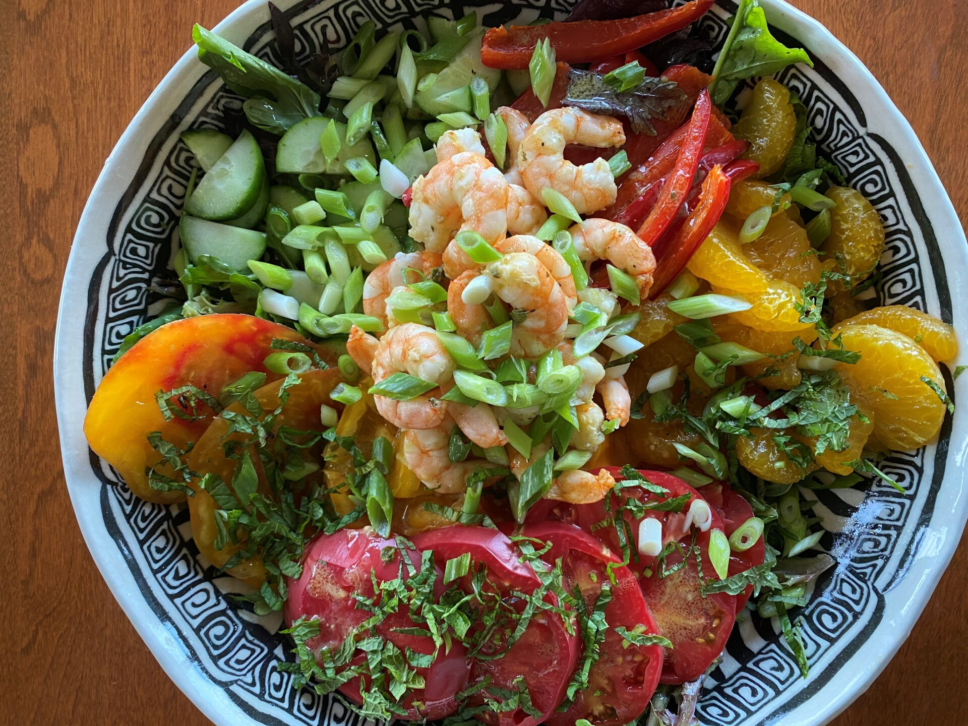 summer salad of shrimp, lettuces, heirloom tomatoes, red peppers, and basil
