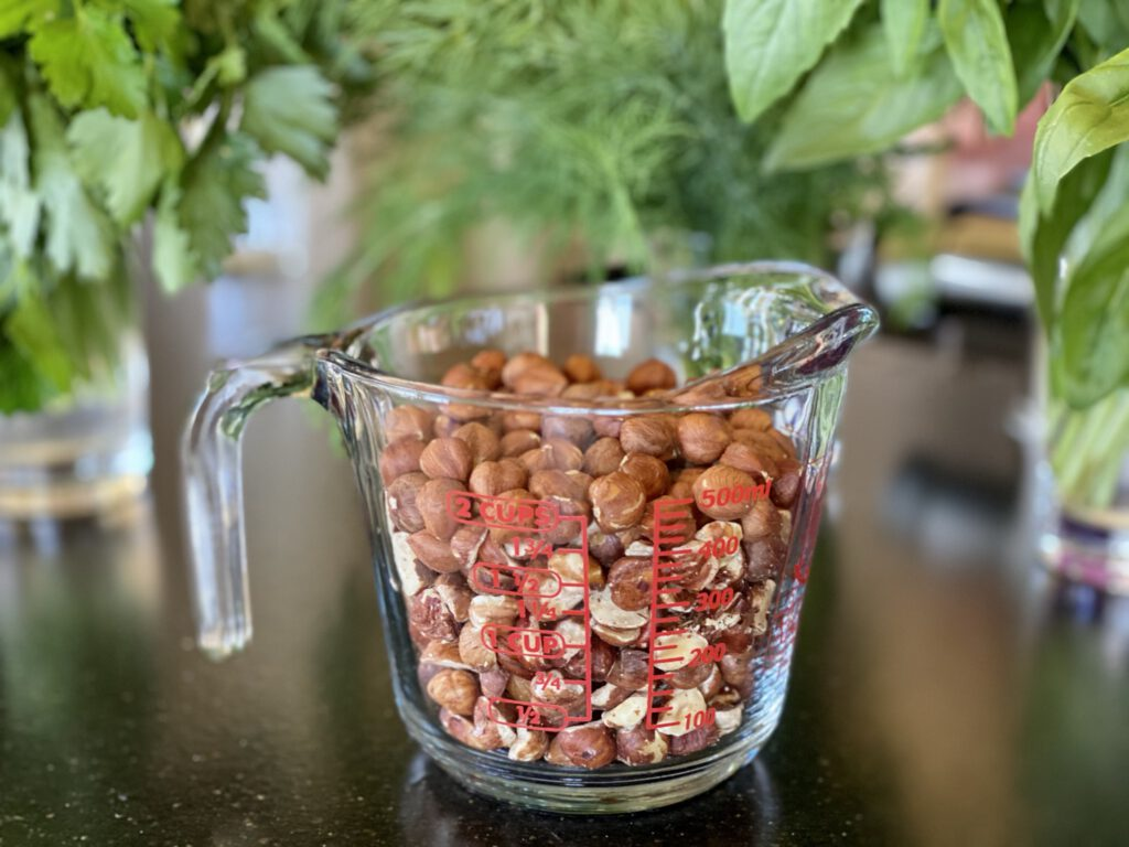 measuring cup filled with hazelnuts