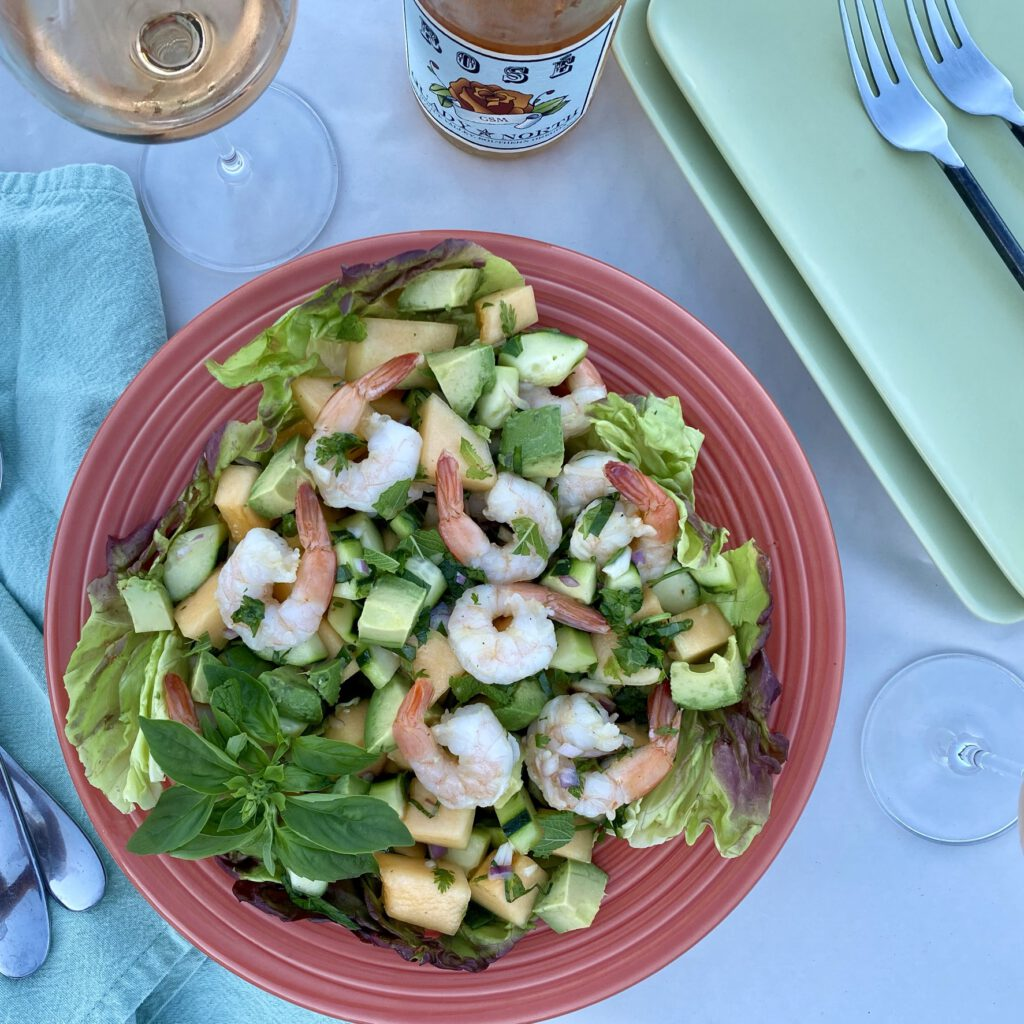 Platter of sweet and spicy shrimp and melon salad