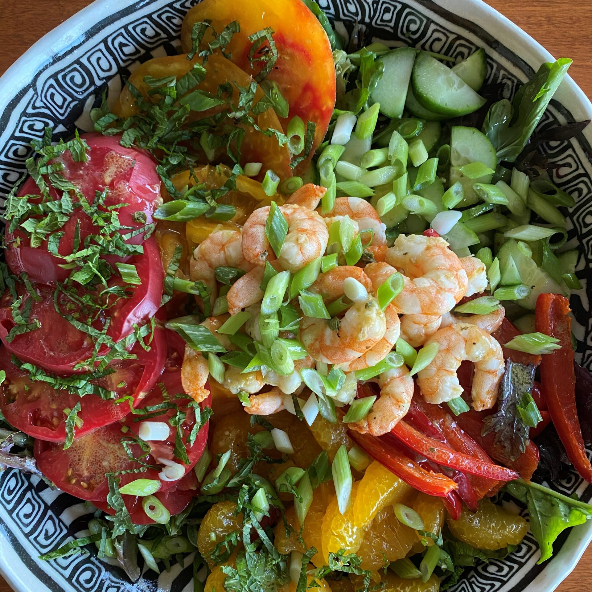 lettuce salad with vegetables and shrimp in bowl