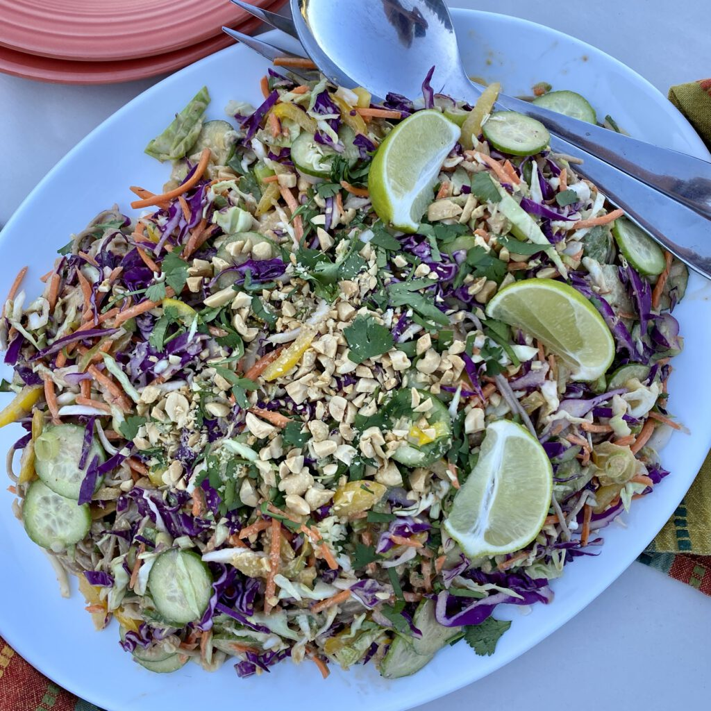 Cold Buckwheat noodle salad with peanut sauce on platter