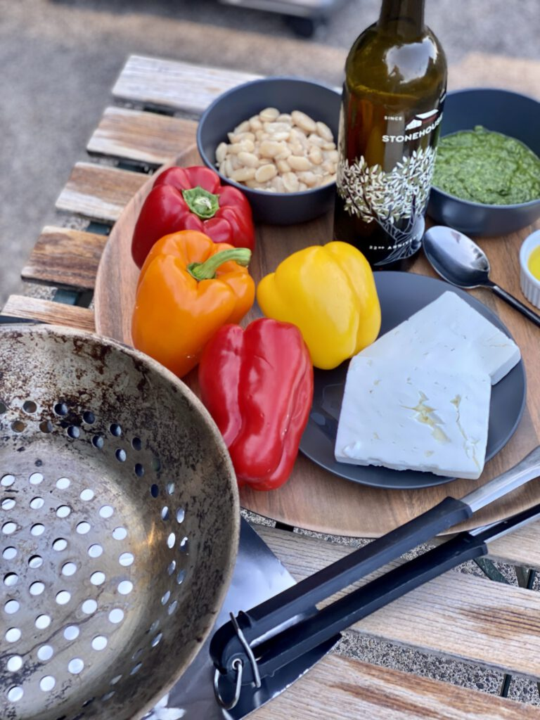 ingredients and tools for roasted red pepper, white bean, feta, nd simple herb sauce