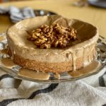 Flourless walnut cake on a cake platter.
