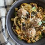 Bowl full of Turkey Zucchini Meatball Pasta + Roasted Lemon Sauce